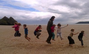 Skipping on Three Cliffs bay with Gower Society Youth